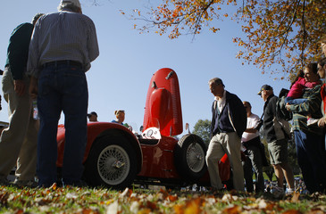 People admire a 1954 Allard J2X under autumn skies at the annual Rockville, Maryland Antique and Classic Car Show