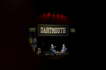 A window frames U.S. Democratic presidential candidate Hillary Clinton as she answers questions from the audience at the Center for Global Business and Government speaker series at Dartmouth College in Hanover