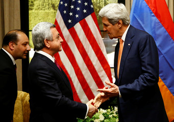 U.S. Secretary of State Kerry talks to Armenia's President Sargsyan in Vienna