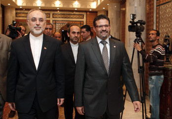 Tunisian Foreign Affairs Minister Rafik Abdessalem arrives with his Iranian counterpart Ali Akbar Salehi in Tunis