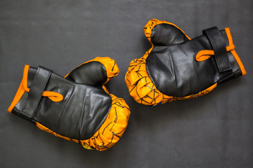 Little yellow children's boxing gloves in the ring