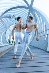 couple of male dancers performance a acrobatic ballet pose
