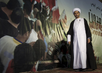 Sheikh Ali Salman, head of Bahrain's main opposition party al-Wefaq, walks off stage after delivering a speech during an anti-government rally in Budaiya, a suburb of Manama