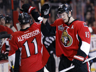 Ottawa Senators' Spezza celebrates his goal with Alfredsson during the second period of their NHL hockey game against the Nashville Predators in Ottawa