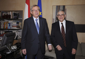 Luxembourg's PM Juncker poses with his Greek counterpart Papademos ahead of their meeting in Luxembourg