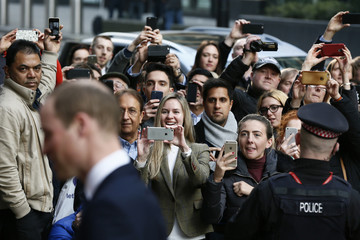 Members of the public photograph and film Britain's Prince William as he arrives for an XLP project visit in London