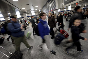 Travelers make their way through a busy Pennsylvania Station in the Manhattan borough of New York City, one day ahead of the Thanksgiving holiday