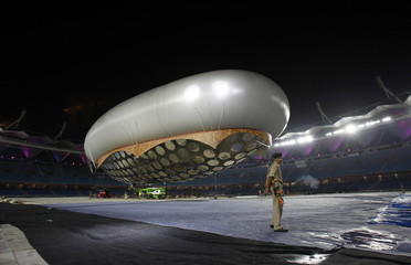 A paramilitary soldier stands guard in front of the giant aerostat inside the Jawaharlal Nehru stadium, in New Delhi