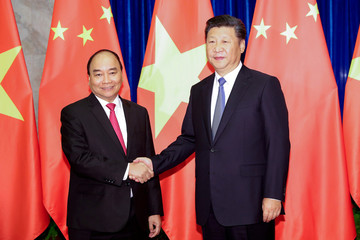 Chinese President Xi Jinping shakes hands with Vietnam's Prime Minister Nguyen Xuan Phuc at Great Hall of the People in Beijing