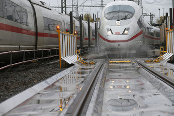 An ICE high speed train of German railway Deutsche Bahn AG approaches the first station of an anti-icing unit at their depot in Frankfurt