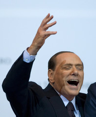Italy Prime Minister Silvio Berlusconi gestures as he attends a meeting in Rome