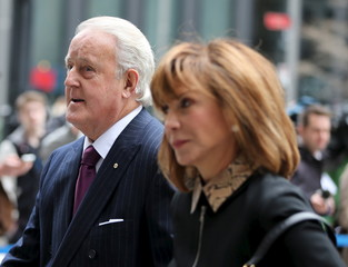Former Prime Minister Brian Mulroney and his wife Mila arrive for the funeral of Senate Speaker Pierre Claude Nolin at Notre Dame Basilica in Montreal