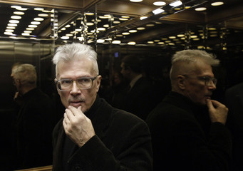 Opposition leader Limonov leaves the Russian Supreme court in Moscow