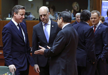 Britain's Prime Minister Cameron, Sweden's Prime Minister Reinfeldt, Cyprus' President Anastasiades, EU Commission President Barroso and Poland's Prime Minister Tusk attend a summit in Brussels