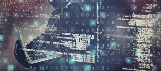 Composite image of female hacker using laptop