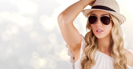 Beautiful woman wearing sunhat and sunglasses