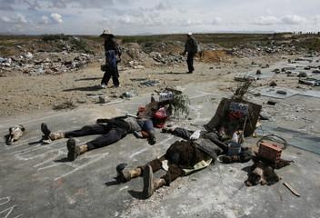 Effigies of Bolivia's Vice President Linera and senator Surco are laid on La Paz - Oruro highway in Ventilla