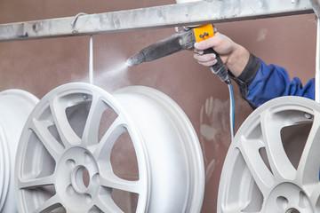 Process of powder coating auto disks