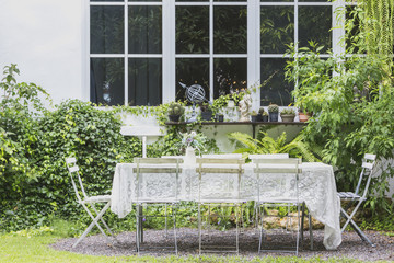 Vintage wooden white bench with ivy and white brick on vintage house background, Concept of Vintage garden style.