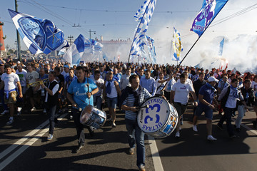 Supporters of Zenit St Petersburg soccer club burn flares and shout slogans as they march towards Petrovsky stadium to attend their team's match against Kuban Krasnodar in central St. Petersburg