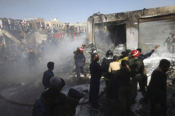 Firefighters work to extinguish fire after a plane crashed in Sanaa