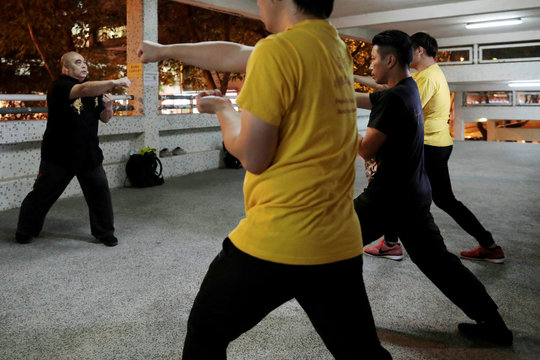 Dragon Sign Kung Fu master Wong Yiu-kau teaches his students at a martial arts class in Hong Kong