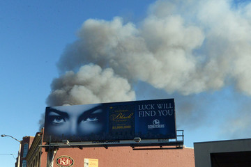 Smoke billows from a fire at a construction site in the China Basin area of San Francisco