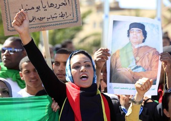 Supporter of Libyan leader Gaddafi takes part in welcoming ceremony for delegation of five African leaders seeking to mediate in Libya's conflict, in Tripoli