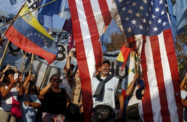 Supporters of Venezuela's President Maduro shout slogans and wave a national flag of Venezuela as they burn a U.S. national flag during a demonstration in Buenos Aires