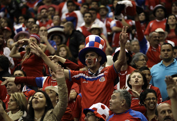Fans shout out support for Costa Rica during the 2014 World Cup qualifying soccer match against Mexico at Azteca stadium in Mexico City