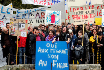 Protesters take part in a demonstration to support migrant arrivals and against the far-right Front National (FN) party rally in La Tour d'Aigues