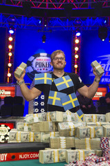 Martin Jacobson of Sweden poses with cash after beating Felix Stephensen of Norway to win the $10 million first prize during the 2014 World Series of Poker main event at the Rio hotel-casino in Las Vegas