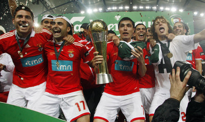 Benfica's players celebrate with their trophy after winning the Portuguese League Cup final against Porto  in Faro