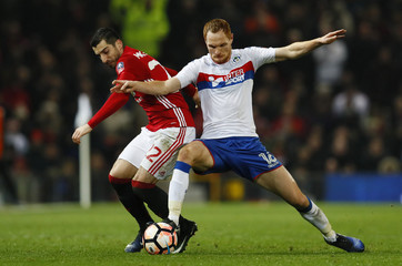 Wigan Athletic's Shaun MacDonald in action with Manchester United's Henrikh Mkhitaryan