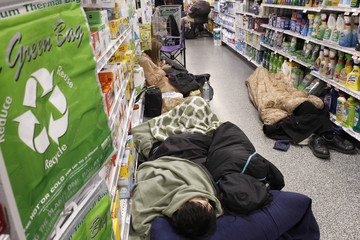 People sleep at aisle of a Publix grocery store after being stranded due to a snow storm in Atlanta