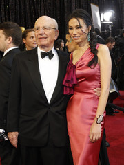 Rupert Murdoch (L), chairman and CEO of News Corporation, and his wife Wendi Deng arrive at the 83rd Academy Awards in Hollywood