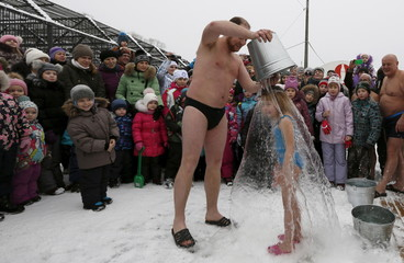 The Wider Image: Swimming in Siberia