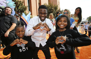 Comedian Kevin Hart arrives with his children Heaven and Hendrix at the 27th Annual Kids' Choice Awards in Los Angeles