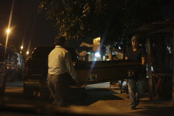 People carry coffin for family member who had died, outside local hospital in San Pedro Sula