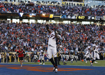 Denver Broncos' Jackson celebrates by throwing the ball into the air after scoring a touchdown on a recovered fumble by Carolina Panthers' quarterback Newton during the first quarter of the NFL's Super Bowl 50 football game in Santa Clara