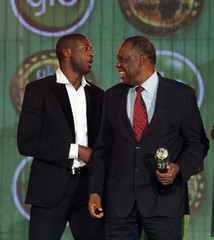 Issa Hayatou president of CAF (Confederation Africaine de Football) stands next to Ivorian soccer player Yaya Toure in Accra