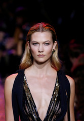 Model Karlie Kloss presents a creation by Lebanese designer Elie Saab as part of his Spring/Summer 2017 women's ready-to-wear collection during Paris Fashion Week