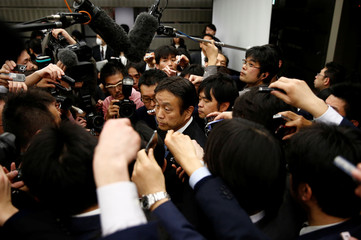 Toyota Motor Corp's senior managing officer Shigeru Hayakawa is surrounded by reporters after a news conference in Tokyo