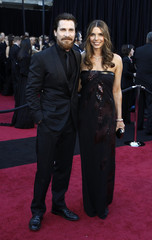 Best supporting actor nominee Bale and his wife Blazic arrive at the Academy Awards in Hollywood