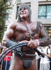 A reveller poses for pictures during the 32th annual gay and lesbian Mardi Gras parade in central Sydney
