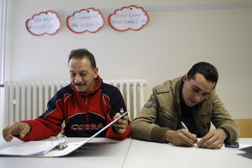 Syrian refugees learn the German language in a school at the 'Friedland' refugee camp' in Friedland