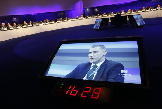 Martin, Director-General, Government and Industry Cyber Security of Britain's intelligence service Government Communications Headquarters (GCHQ) is seen on a screen at the CyberSecurity summit in Bonn