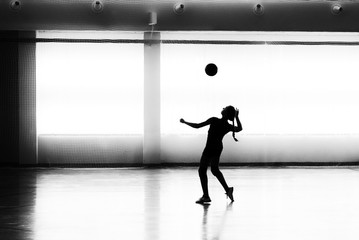 Girl playing volleyball in the sports club