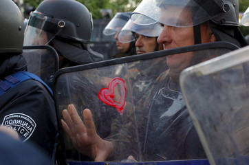 A heart shape drawn by a demonstrator on a police shield is pictured during a protest against the government, in front of the EU office in Skopje