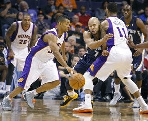 Memphis Grizzlies Bayless gets caught in pick by Phoenix Suns Morris as Telfair drives to the basket during the fourth quarter of their NBA basketball game in Phoenix
